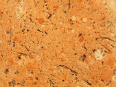 Red limestone texture.Background. — Stock Photo