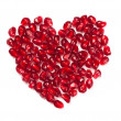 Heart shaped pomegranate seeds - Stock Photo