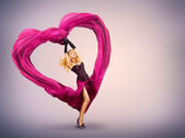 Young Woman with Silk Valentine Heart — Stock Photo