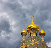 Orthodox church with golden domes. — Stok fotoğraf