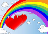 Hearts in the air with a rainbow background — Stock Vector