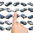 Man is choosing car with finger — Stock Photo