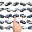 Man is choosing car with finger — Stock Photo #8485323