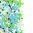Colorful puzzle in various shapes — Stock Photo