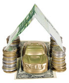 A golden car under garage roof made from banknote — Zdjęcie stockowe
