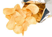 Tasteful chips from golden potatoes — Stock Photo