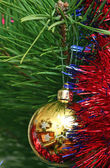 Yellow Cristmas ball on the Cristmas tree — Stock Photo