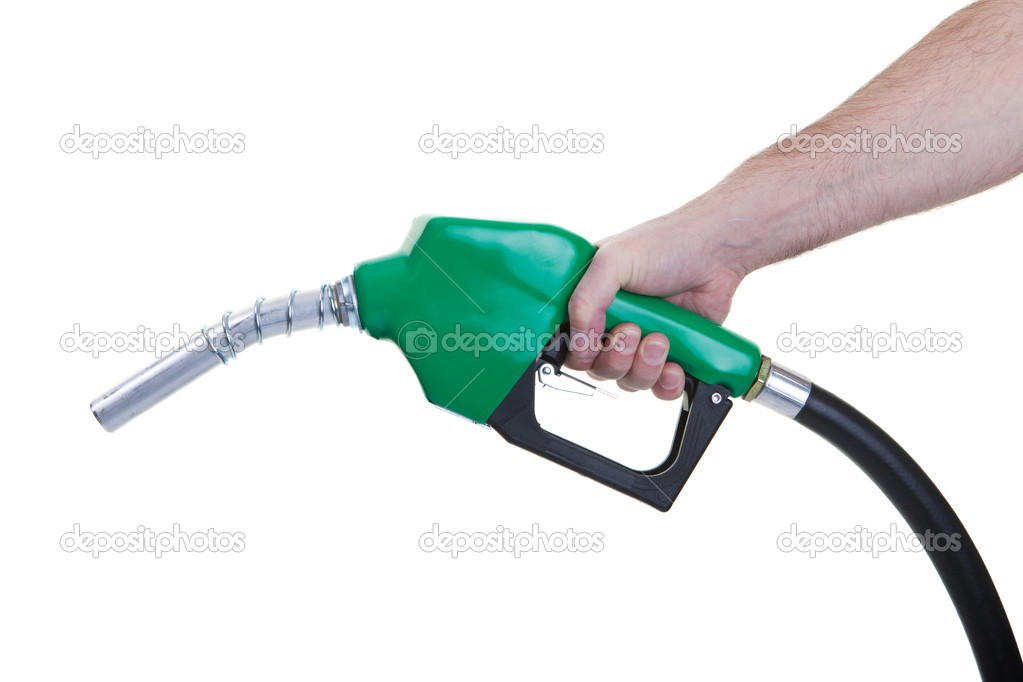 A man holding a green gasoline nozzle on a white background. — Stock Photo #9569102