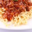 Fusilli bolognese — Stock Photo