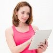 Woman holding in hand a tablet touch pad, — Stockfoto