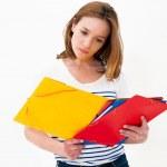 Beautiful woman with a folder — Stock Photo