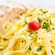 Tasty pasta with salmon - Stock Photo