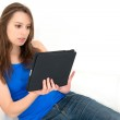 Woman on the couch with her tablet — Stock Photo #10620722