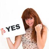 Женщина с правления yes — Стоковое фото
