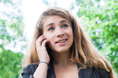 Woman talk on a cellular telephone — Stock Photo