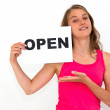 Young woman with board OPEN — Stock Photo