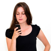 Young woman talk on a cellular telephone — Stock Photo