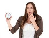 Woman holding alarm clock — Stock Photo