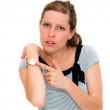 Woman checking the time on her wrist watch — Stock Photo