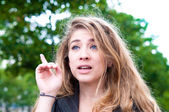 Young woman with her finger up — Stock Photo