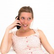 Woman on a white sofa making a phone call — Stock Photo #9737596
