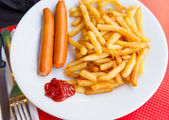 Grilled sausage served — Stock Photo
