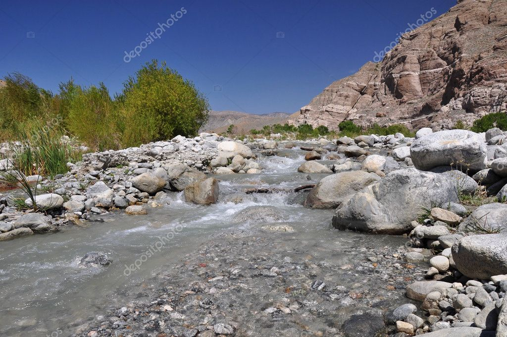 A rushing creek flows through a desert canyon near the town of Palm Springs, California. — Stock Photo #10080166