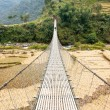 Hanging footbridge in Nepal — Stock Photo