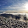 Evening sunshine and inversion clouds on mountains — Stock Photo
