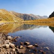 Stock Photo: Autumnal view of Jamnicke pleso lake from rohace mountains