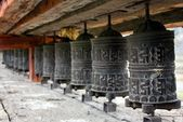 Many prayer wheels — Stock Photo