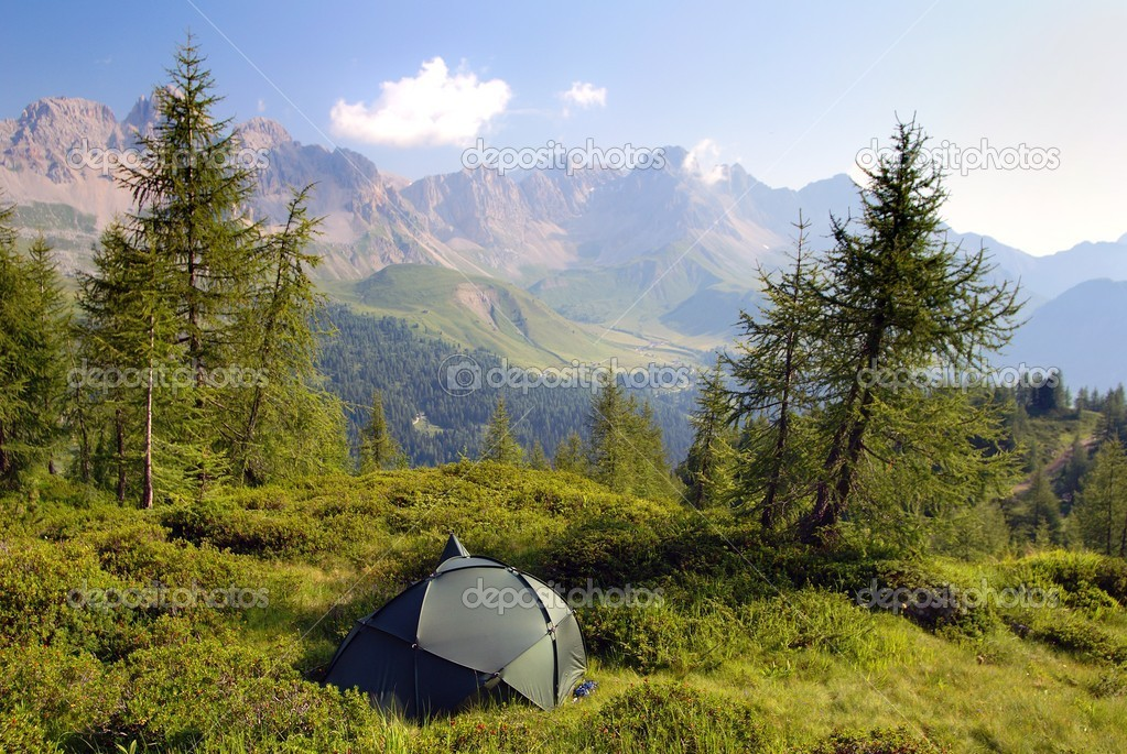Tourist tent in the green forest om mountains   Stock Photo #9631881