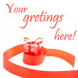 Red ribbon with present box — Stockfoto