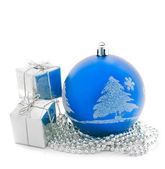 Blue Christmas ball with little present boxes — Stock Photo