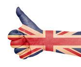 UK flag on thumb up gesture — Stock Photo