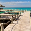 Stock Photo: Bridge lead to tropical beach in a turquoise seascape