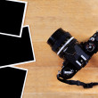 Old film camera and photo paper on wooden table — Stock Photo