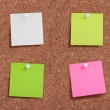Colorful post it paper pin on cork board — Stock Photo #8539222