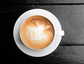 White cup of hot coffee latte — Stock Photo