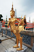 Golden Kinnaree (half woman - half bird) figure — Stock Photo