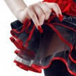 Female bottoms in black and red skirt isolated on white background — Stock Photo
