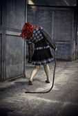 Zombie girl walking with armature — Stock Photo