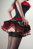 Red and black corset and fluffy skirt — Stock Photo
