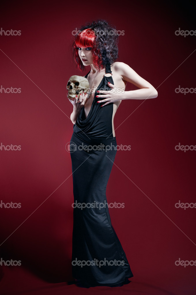 Elegant gothic woman with skull — Stock Photo #10241248