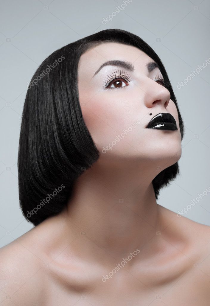 Studio portrait of young brunette with black lips — Stock Photo #10244236