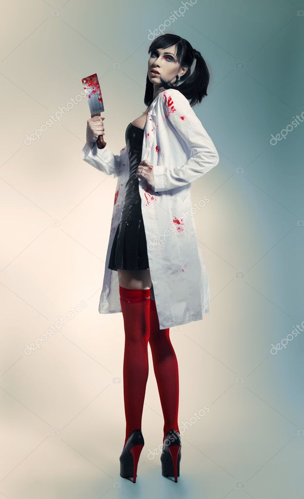 Crazy nurse with bloody knife — Stock Photo #10244315