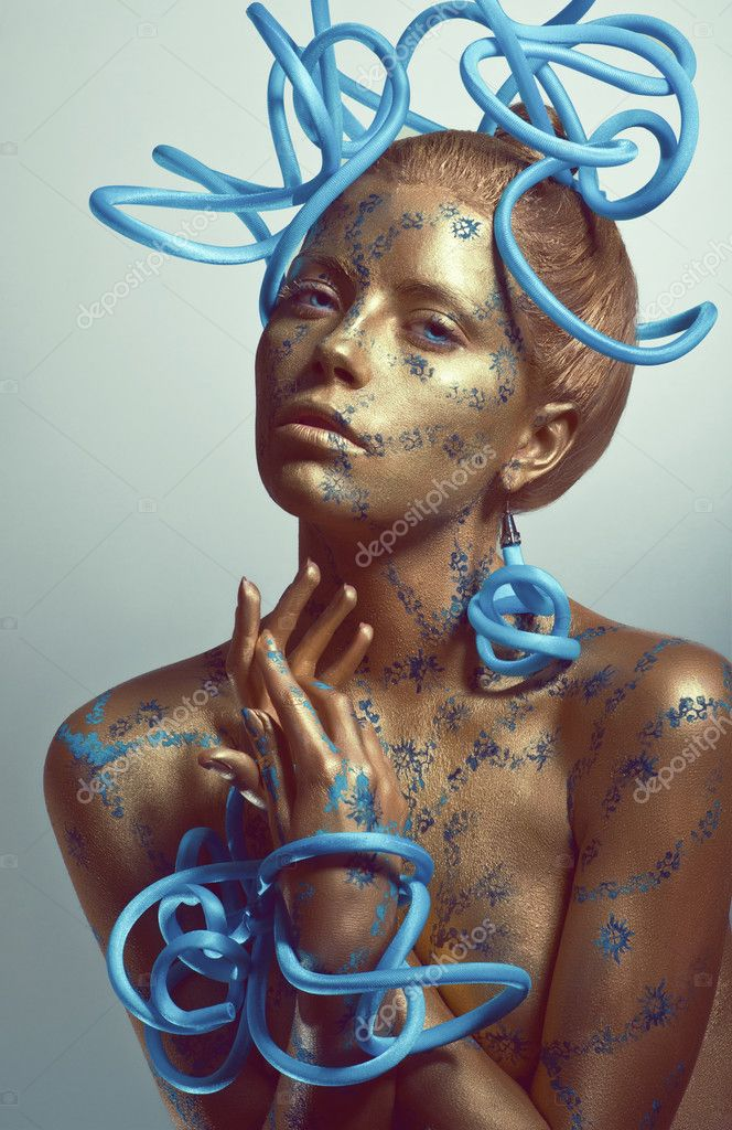 Woman with golden body-art and blue tubes — Stock Photo #10244372