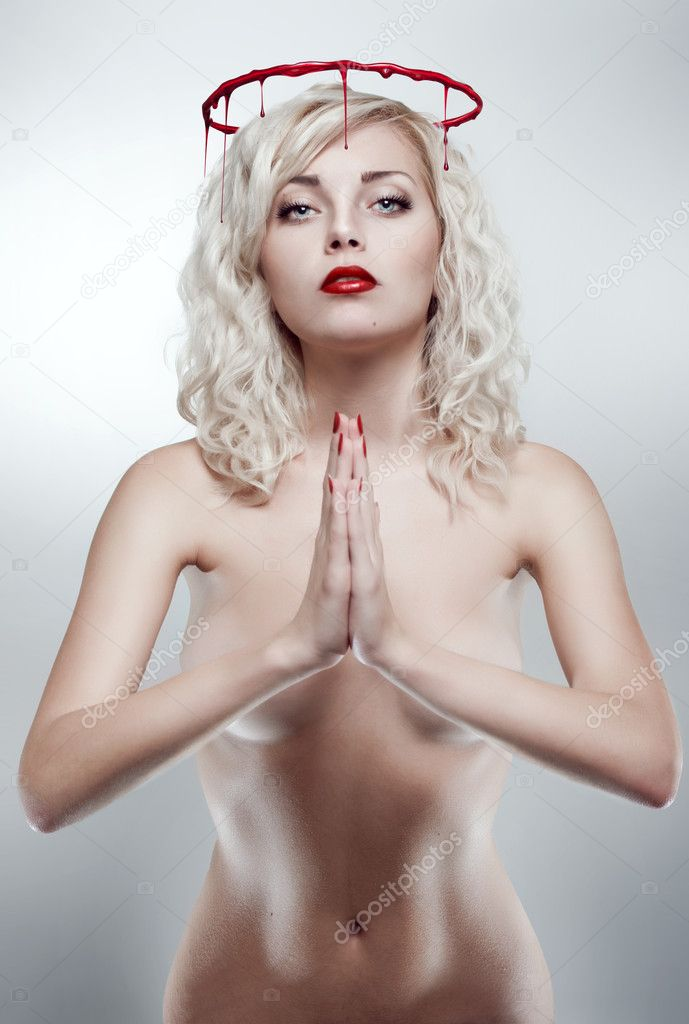 Young blonde praying woman with bloody nimbus — Stock Photo #10244384