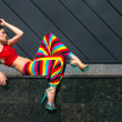 Fashion model in colorful outfit - Foto Stock