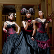 Three gothic girls with horns - Foto Stock
